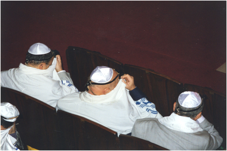 Turkey – Istanbul. In the Neve Shalom Synagogue, Jews with their kippahs (skull-cap) and talliths (prayer-shawls). At a certain point during the prayers they cover their faces with their shawls.