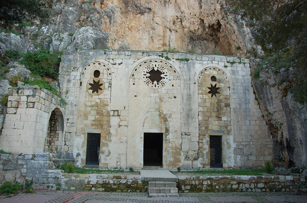Turkey – Antakya, The Cave Church Early Christians first met for worship in the homes of converts, in rooms furnished for this purpose, and also in catacombs, subterranean caves which could be enlarged and then used in secret, without fear of being discovered. They were small chapels hewn out of the rocks, and they are examples of the first Christian architecture in a simple form. It is said that St. Peter preached to the Christian population of Antioch from a now famous cave church in today's Antakya, but this is open to question, as are the exact dates of his sojourn in that city. Theologians are able to agree only on his founding in Antioch, together with St. Paul and St. Barnabas, one of the first Christian communities in the world somewhere between 47 and 54 CE. A Cypriot called Joseph, was given the name Barnabas by Jesus's other disciples. Barnabas joined Paul at Tarsus, where the two men preached together. Their strategy of preaching to non-Jews set them apart from the other disciples. St. Barnabas disappeared without trace. This church was surely one of the first ever built, and arguably the place where the word'Christian' was first used. In other places in the Middle East, Christians were called'Nazarenes'. In the 12th century, Crusaders rebuilt the facade of the church, and traces of floor mosaics are believed to date from the 5th century CE. On the left of the altar, there is a tunnel, now blocked, through which those early Christians could escape in the event of an assault on their service. Attended by the members of the present small Christian community in Antakya, every year on 29th June, a service is held here to commemorate the anniversary of the death of St Peter, (he too was crucified) , and Mass is celebrated here every Sunday afternoon.
