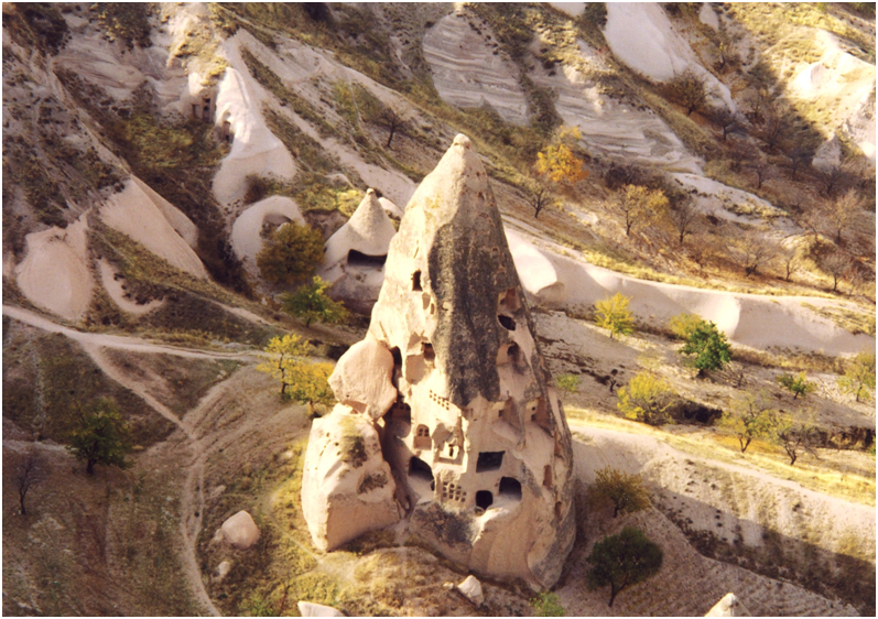 The volcanic surface–cover of Cappadocia has undergone erosion by rain, snow, floods, streams, strong winds and changes in temperature.  Although the soft, porous rock, known as tufa, is readily carved and shaped when moistened, afterwards it rapidly sets hard. Here, the geological structure of the locality has facilitated the formation of underground townships and cave churches. The first Christian immigrants to arrive in this region settled in the underground dwellings opened up by the Hittites two thousand years before. These were enlarged and developed.  They became a safe refuge and hiding-place for these Christians and were equipped with wells, food storage houses cemeteries, ventilation and heating facilities. Turkey – Cappadocia, Uchisar