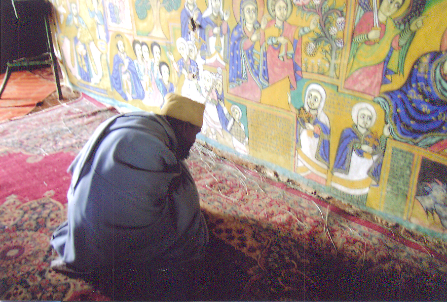 Monk of Ura-Kidanemeret stands infront of the Holy of Holies – the inner sanktum of all Ethiopian Orthodox churches which contains the representation of the Ark of the Covenant and into which only the most senior priests are admitted. Ethiopia – Lake Tana