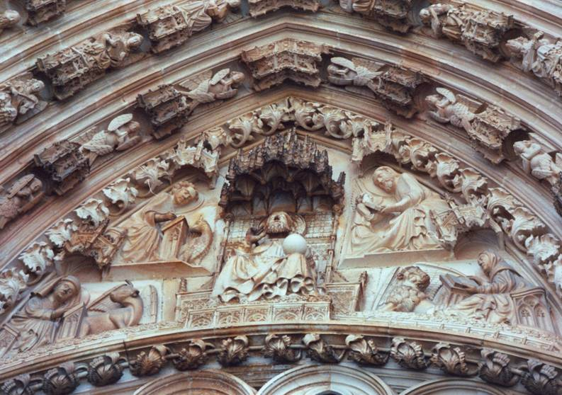 Portugal – Batalha, the Abbey (14th-16th Century). Jesus, in the middle, with a globe in His hand, indicating Christianity's universality. Around Him are the four Gospel–writers and their symbols. Each Gospel uses a symbolic emblem, taken from the Books of Ezekiel and the Revelation. These are known as the Tetra morphs, the four pictorial representations of the attributes of the four Evangelists: A human face or figure for Saint Matthew, a lion for Saint Mark, a winged ox for Saint Luke and an eagle for Saint John.