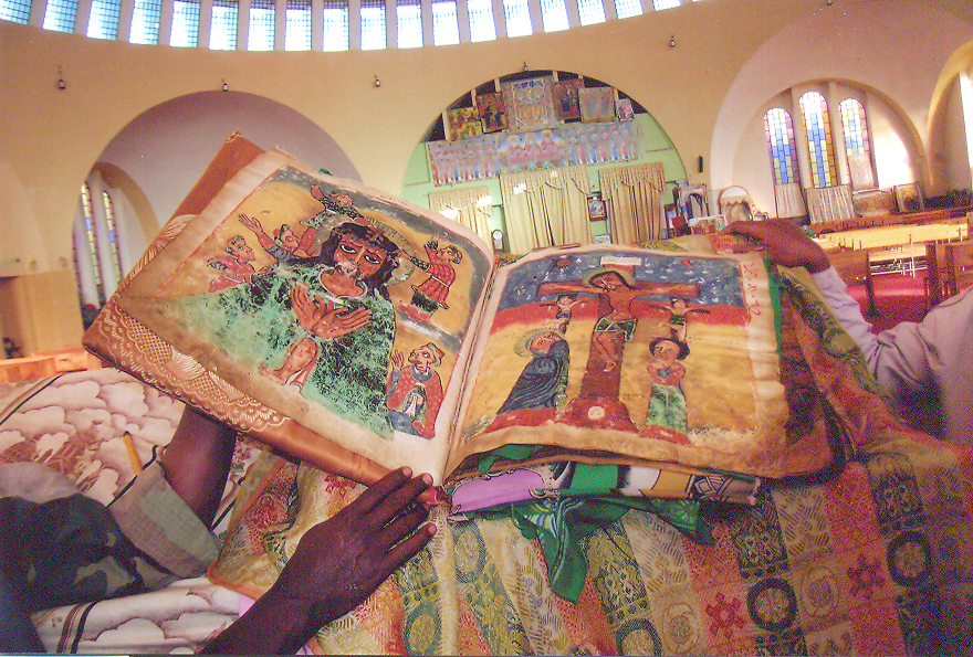 İlluminated Bibles, hand-painted on parchment by priests and monks and bound within wooden covers, are still used in church services today. They are written in Ge'ez, the language from which many of the present-day Ethiopian tongues are derived. Ethiopia – Axum.