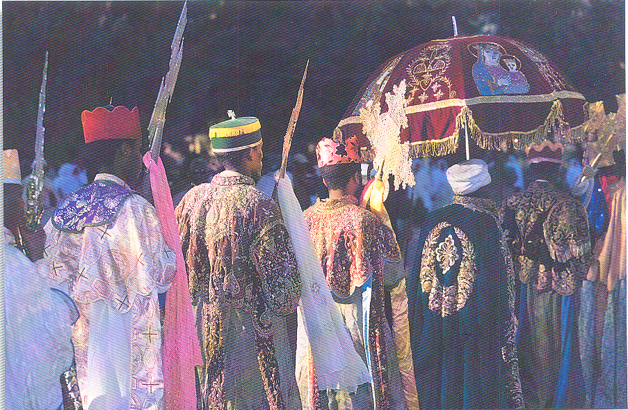 Renewal of Baptism procession, January 19th. Music and dance are an integral part of the religious ceremony in the Ethiopian Orthodox Church. During the procession, priests sing to a mournful drum rhythm, the high priests hold ornate gold and silver crosses. Ethiopia – Timkat, Axum.