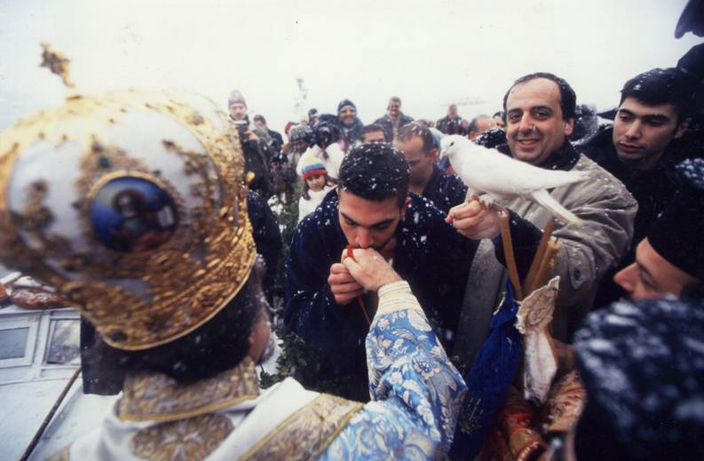 The young Orthodox who rescued the cross from the Marmara Sea, receiving the blessing.