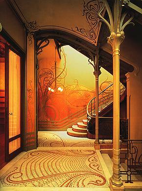 Victor Horta, Tassel Evi, 1893.  Bu bina, ilk Art Nouveau bina olarak kabul edilmektedir. Horta'ya, çalışmalarından ötürü Baron ünvanı verilmiştir. Eserlerinden dört tanesi UNESCO Dünya Mirası Listesi'ne alınmıştır: Hotel Tassel, Hotel Solvay (1895-1900), Hotel van Eetvelde (1895-1898), günümüzde müze olan Horta Evi ve atelyesi (1898). Horta, yaptığı binaları her şeyi ile tasarlayan ilk mimarlardandı. Ayrıca, merkezi ısıtma, elektrikle aydınlatma gibi ileri teknikleri de binalarında kullanıyordu. Victor Horta, Birinci Dünya Savaşı sonrasında modası geçen Art Nouveau motifleri yerine daha geometrik ve kübik elemanlar kullanmaya, Art Deco'yu haber vermeye başladı.