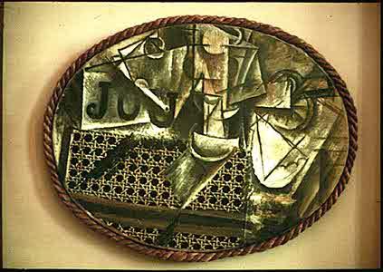 """Pablo Picasso, Hazeranlı Natürmort, 1912. Çerçeve olarak gerçek bir halat kullanılan bu tabloya bakarak """"Gerçek"""" meselesine yaklaşımlarını izleyebiliriz: Resimdeki limon ile bardak Kübizm'in gerektirdiği şekilde çizilmiş. Ama en gerçekçi gözüken hasır, hasır değil, muşamba."""