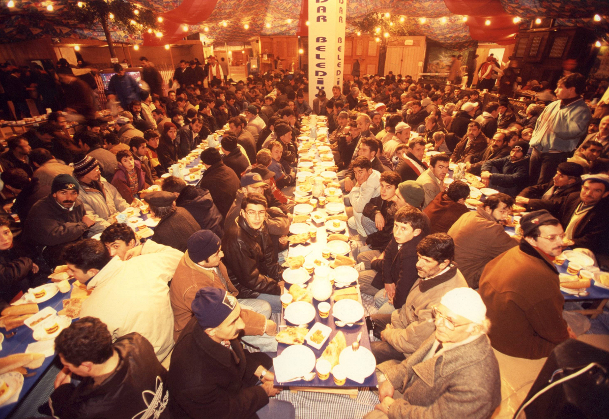 Turkey – Istanbul. Communal breaking of the fast. The food is provided free by Istanbul Municipality.