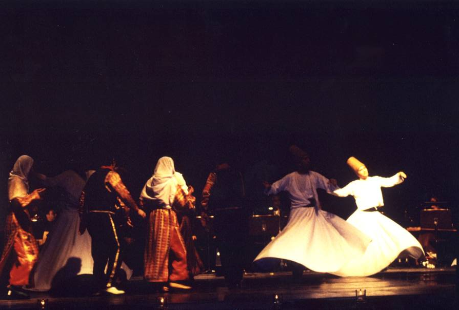 This is a photograph of Sema and Semah being performed side by side on the same stage.