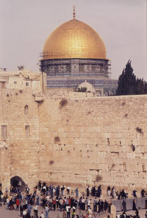 The Temple Mount is one of the world's most sacred spots. It has been identified as the biblical Mount Moriah.  Arabs name it Haram es Sharif, the Noble Courtyard. It was here that Solomon created the First Temple. After its destruction, it was replaced by the Second Temple.  The Wailing Wall is a remnant of the 2nd century CE wall that once supported the Temple Mount. At the center of the Temple Mount stands the Dome of the Rock (Qubbat al-Sakhra).  The shrine is built over the sacred Rock (Sakhra) on which Abraham prepared to sacrifice his son Isaac/Ishmael and from which Mohammed is said to have ascended to Heaven.