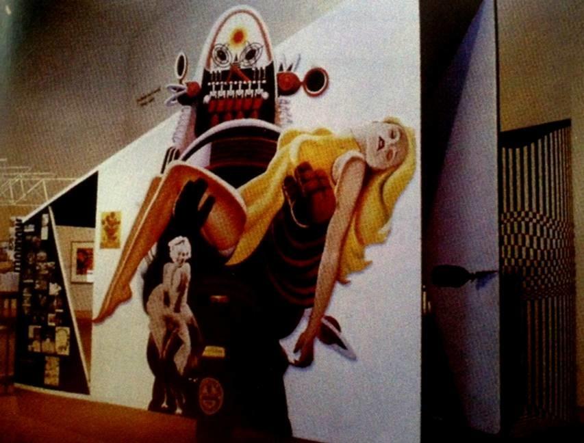 1956 yılında Richard Hamilton, John McHale (1922-1978) ve John Voelcker (1927-1972)  Grup 2  imzasını taşıyan This is Tomorrow sergisinde, 1955 yılı yapımı The Seven Year Itch adlı filmden Marilyn Monroe'nun görüntüsü; 1956 yılı yapımı Forbidden Planet adlı filmden bir karakter olan Robot Robbie'nin bir görüntüsü; büyük bir Guinness şişesi ile sergi, çağının karakteristiklerini yansıtmaktadır. Eserde, o döneme ait medya (film, televizyon, dergiler) kullanılmıştır. Guinness ise, bir ürün ve marka olarak, tüketim kültürünün bir parçasıdır. Hem medyaya hem de tüketime yapılan göndermeler, dönemin özelliğidir. This is Tomorrow, popüler kültür konusunu işlemesi, geleneksel sanatsal formların dışına çıkması (çünkü ne resim, ne de heykeldir) ile, popüler kültür, medya ve tüketim kültürüne tepki olarak ortaya çıkan sanatın erken bir örneğidir. This is Tomorrow sergisi, Enstalasyon Sanatı'nın kökenindeki eserlerden biridir (diğerleri Oldenburg'un The Store adlı eseri ve Neo Avangard'ın diğer tezahürleridir). Ahşap, boya, fiberglas, kolaj, sünger, mikrofon, film projektörleri kullanılarak yapılmış olan eserin en yüksek noktası 4 metredir. 1991 yılında eser yenilenmiştir. Fotoğraf: Graham Whitham.