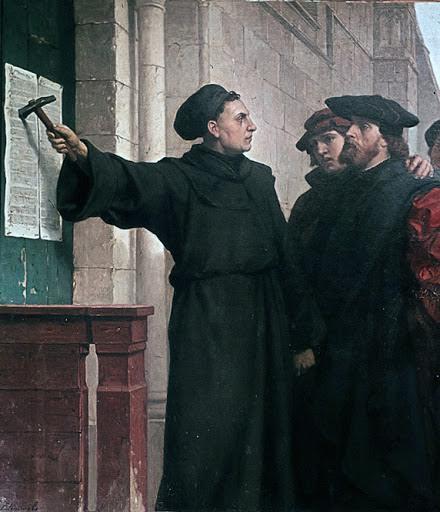 Dr. Martin Luther, 31 Ekim 1517 tarihinde Wittenberg'de bulunan Schlosskirche'nin (Kale Kilisesi) kapısına 95 tezini çivilerken. Fotoğraf: www.hristiyanforum.com